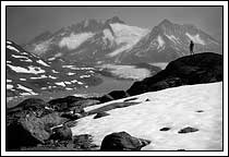 black and white photo of a hiker, silhouetted in the Chugach mountains, alaska
