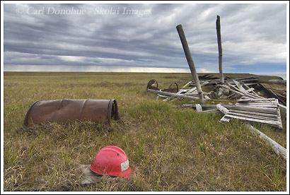 Oil barrels and debris from exploratory drilling, coastal plain, ANWR, Alaska.