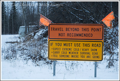 Sign warning of danger, dangerous weather and road conditions on the McCarthy Road, in winter, Wrangell - St. Elias, Alaska.