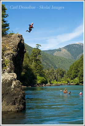 Rafters take a  quick break for a rock jumping session on the Futaleufu River, Patagonia, Chile.