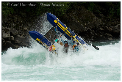 A cataraft flips over in the massive Class IV rapid, Mundaca, on the Futaleufu River, Patagonia, Chile.