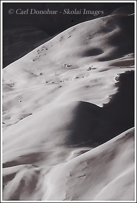 A snow covered glacial moraine, black and white photo, in early morning light, mid winter, on the Kennecott Glacier, Wrangell - St. Elias National Park, Alaska.