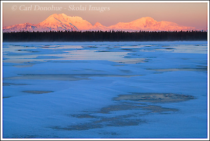 Mt Drum and Mt Sanford Rise over the Copper River Basin and Willow Lake,, Wrangell St. Elias national park, Alaska.