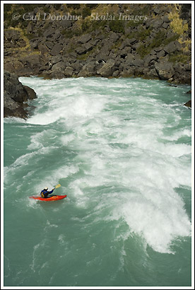 A kayaker runs the huge whitewater of the first of 5 Class V rapids on the Baker River, Patagonia, Chile.