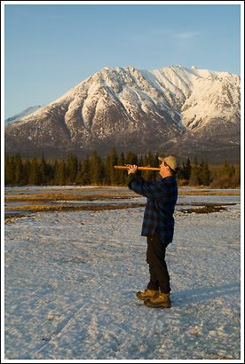 A Hiker playing Native American Indian Flute in springtime in Wrangell St. Elias National Park, Alaska.
