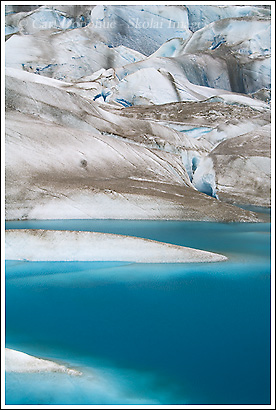 Small blue tarn on the Tana Glacier, Wrangell - St. Elias National Park, Alaska.