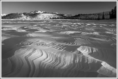 Windblow snow patterns over frozen Twin Lakes, near the Nabesna Road, Wrangell - St. Elias National Park, Alaska.
