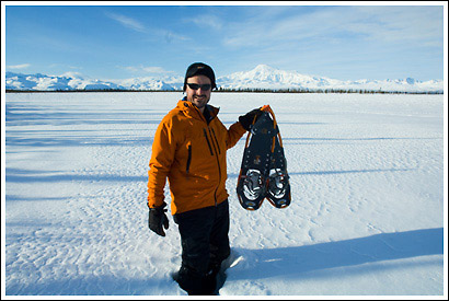 Hiker with snowshoes, winter, Wrangell - St. Elias National Park, Alaska.