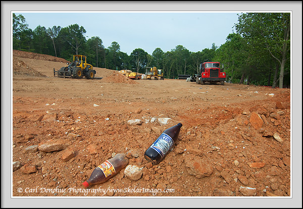 Trash bottles and construction equipment on construction site, Marietta, Atlanta, Georgia
