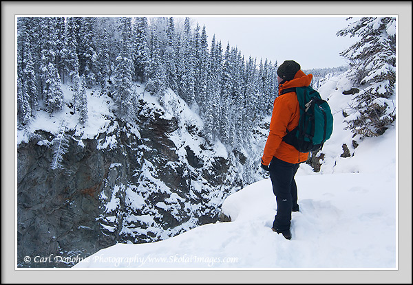Hiking in winter along the rim of the Kuskulana Gorge, Wrangell - St. Elias National Park and Preserve, Alaska.
