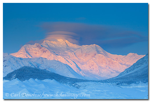 Dawn rising over Mount Blackburn, elevation - 16,390 feet (4,996 M), winter, Wrangell - St. Elias National Park and Preserve, Alaska