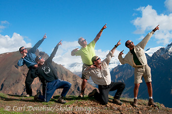 5 intrepid backpackers do 'usain bolt' after crossing the Goat Trail, Wrangell - St. Elias National Park, Alaska.