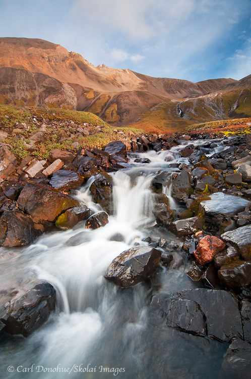 A waterfall in the high alpine mountain country of Wrangell - St. Elias National Park and Preserve, Alaska.