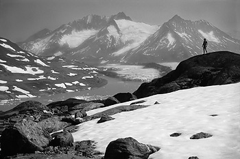 A backpacker stands, naked, in the Chugach Mountains, Wrangell - St. Elias National Park and Preserve, Alaska.