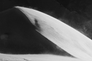 Black and white photo of wind blown snow on a snow covered ridge, winter, Wrangell - St. Elias National Park, Alaska.