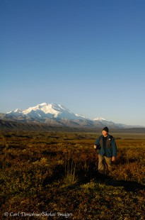 Hiking in Denali National Park, with Mount McKinley in the background.