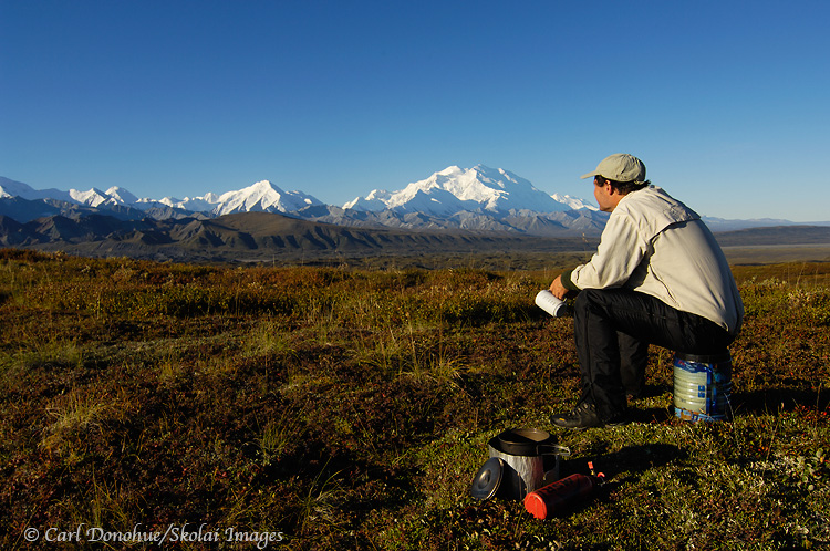 A backpacker and Mount McKInley, Denali National Park, Alaska.