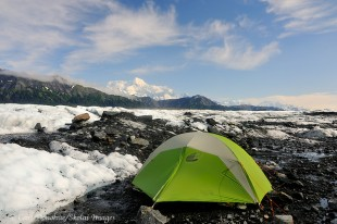A tent on Malaspina Glacier and Mt. St. Elias.