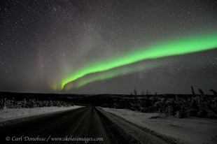 The Dalton Highway and the aurora borealis overhead.