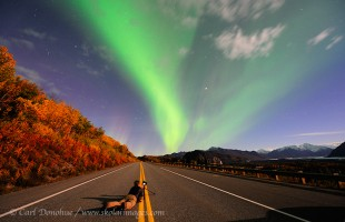 Photographing the Northern lights on the Glenn highway, Chugach Mountains, Alaska.