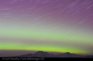 Aurora borealis and star trails, over Wrangell Mountains, Alaska.