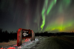 Dalton highway sign and northern lights, Alaska.