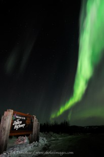 Dalton highway sign and aurora borealis