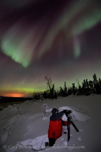 Photographer shooting northern lights in Arctic Alaska.