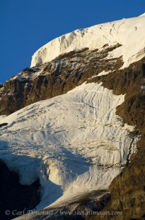 Broken glacier hanging from the steep rocky face of an unnamed peak in Wrangell - St. Elias National Park and Preserve, Alaska.