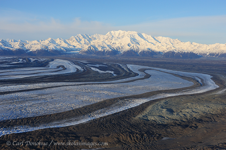 Marbled moraines on the edge of the Malaspina Glacier, below towering Mt. Cook, in the Saint Elias Mountain Range. Mount Cook, Wrangell - St. Elias National Park and Preserve, Alaska.