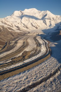 Kennicott Glacier flows off Mt. Blackburn. Medial and lateral moraines follow the path of the glacier. Kennicott Glacier, or Kennecott Glacier, Wrangell - St. Elias National Park and Preserve, Alaska.
