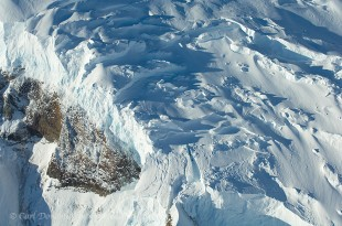 Aerial photo of ice breaking and cracking on a glacier hanging on the steep sides of Mt. Blackburn, Wrangell - St. Elias National Park and Preserve, Alaska.