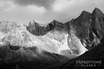 A black and white imagoes the Maidens, jagged granite peaks in the Arrigetch Peaks of Gates of the Arctic National Park and Preserve, Alaska.