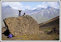 mother and daughter celebrate climbing a large boulder, Wrangell - St. Elias National Park, Alaska