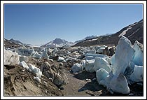 icebergs riddle the land after the Iceberg lake drains in late summer. Wrangell - St. Elias National Park, Alaska