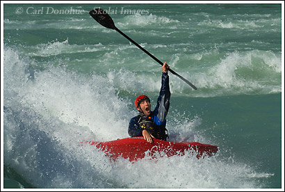 A whitewater kayaker on a play wave, Baker River, Chile.