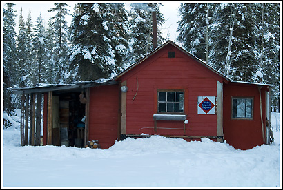 A cabin in the woods in winter, Wrangell - St. Elias National Park, Alaska.