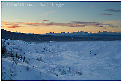 Sunrise over the Kennecott River basin and the distant Chugach Mountains, in winter, Wrangell - St. Elias National Park, Alaska.