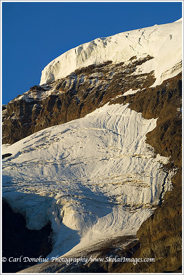 Ice and snow form a glacier on one of the peaks at Hole in the Wall, Skolai Pass, Wrangell - St. Elias National Park, Alaska.