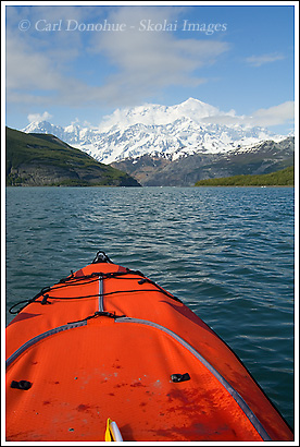 Sea Kayaking in Icy Bay, Mt. St. Elias in the background, Wrangell - St. Elias National Park Alaska.