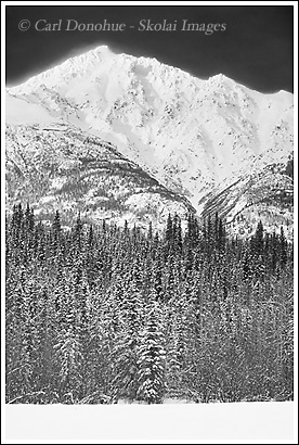Black and white photo of a mountain, snow-capped, in winter, Crystalline Hills, Wrangell - St. Elias National Park, Alaska.