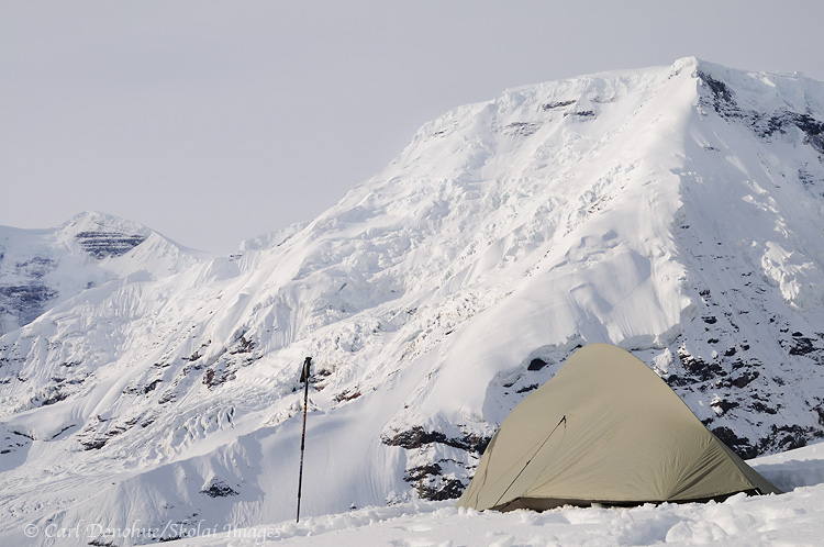 Backcountry campsite, with Big Agnes Seedhouse SL1 tent, facing Mt Jarvis, with fresh snow on the ground, Wrangell - St. Elias National Park and Preserve, Alaska.