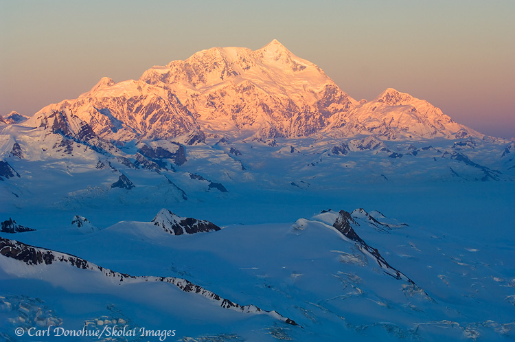 Late alpenglow on Mt St Elias - aerial photo.