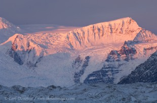 Stairway Icefall and the Root Glacier catch late day alpenglow, as a dusting of fresh snow signals the onset of winter. Wrangell St. Elias National Park, Alaska.