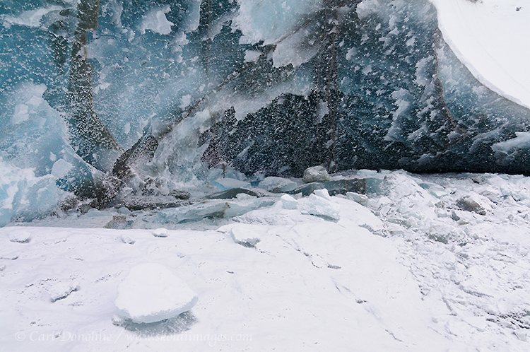 An ice cave on the Kuskulana Glacier, in the Wrangell Mountains. Winter snow and freezing temperatures ice up the water of the Kuskulana River, and the this wall of ice is a myriad of patterns, colors, and textures. Kuskulana Glacier, Wrangell - St. Elias National Park and Preserve, Alaska.